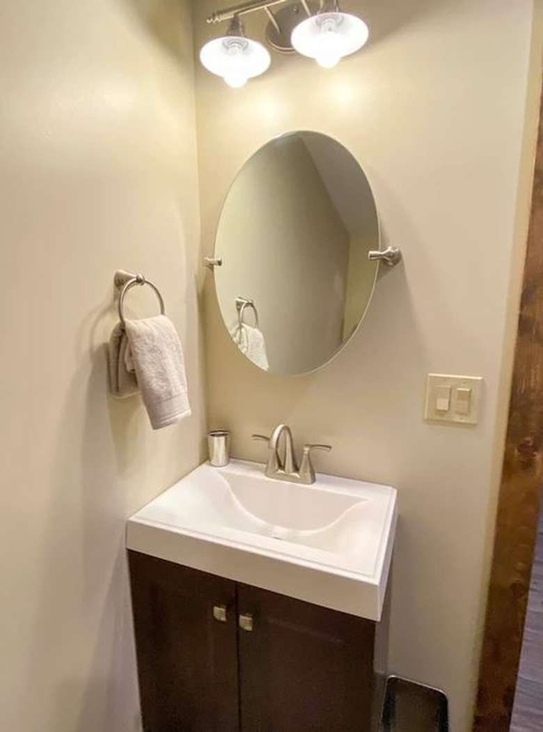 bathroom sink with mirror over it