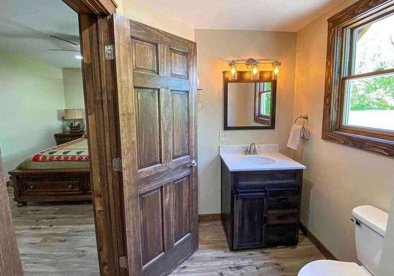 door open leading into bathroom from bedroom