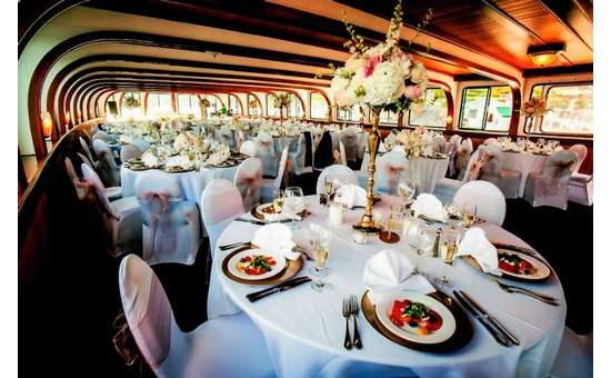 tables on a boat decorated for a wedding