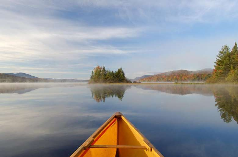 front of a canoe on a lake
