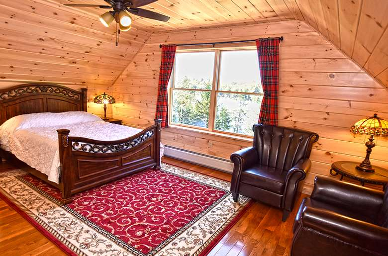 bed on a red rug in a bedroom