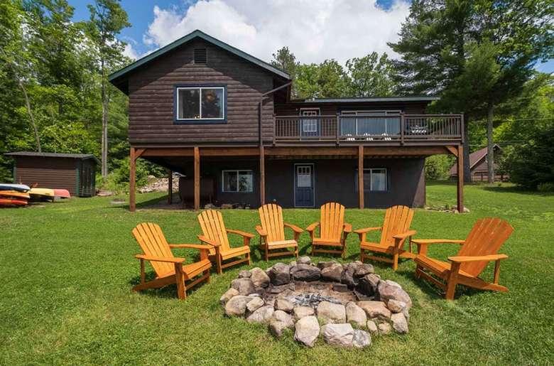 Adirondack chairs surrounding a fire pit