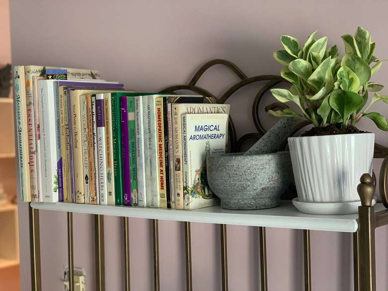aromatherapy and related books on a shelf