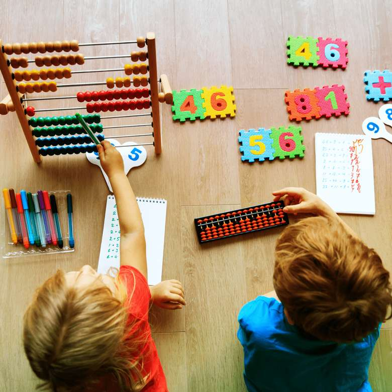 two kids with math related toys