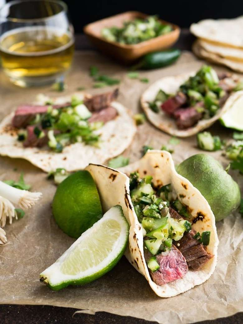 tacos and ingredients on a table