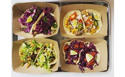 soft tacos displayed in four cardboard holders