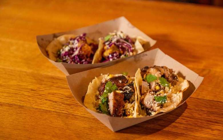 soft tacos displayed in two cardboard holders
