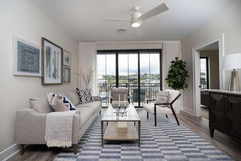 apartment living room area, floor to ceiling glass door