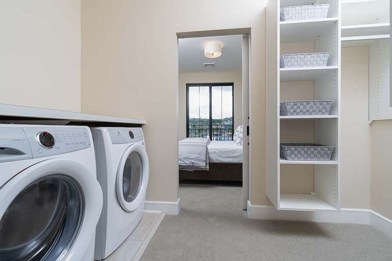 washer and dryer in walk-in closet