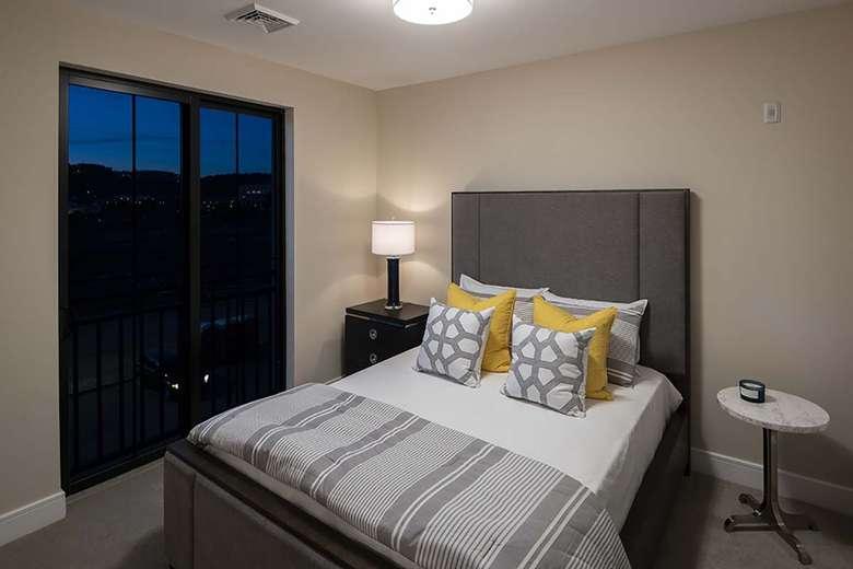 bed by floor to ceiling glass door