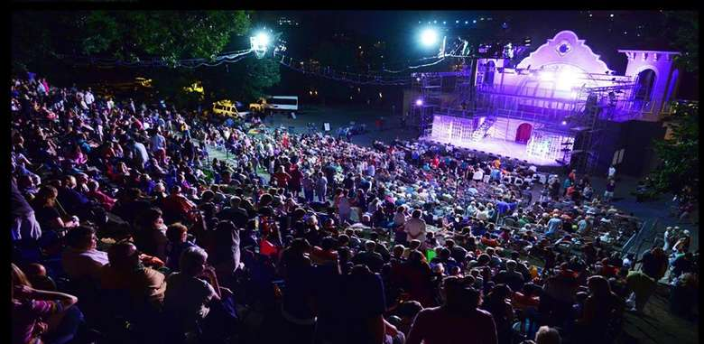 night view of audience watching an outdoor musical