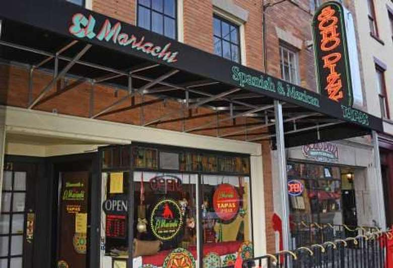 outside restaurant with entrance roof that says el mariachi spanish and mexican tapas