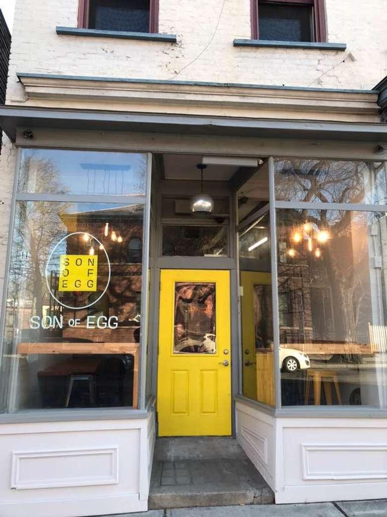 yellow door outside a restaurant