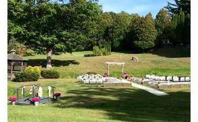 wedding ceremony setup in wooded area