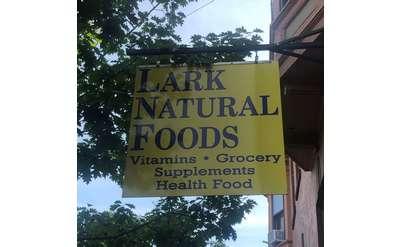 Lark Natural Foods sign