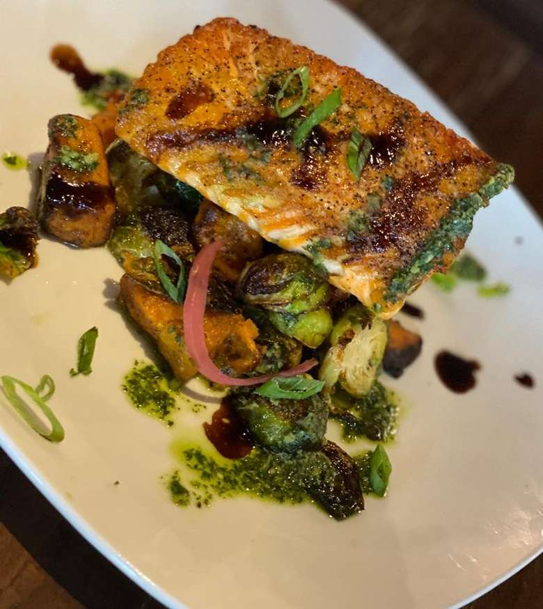 pan seared salmon with Brussels sprouts on a plate