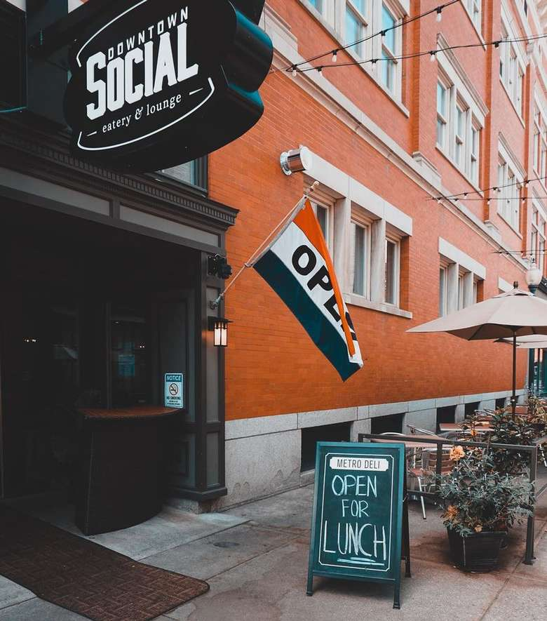 downtown social sign above door and patio near building