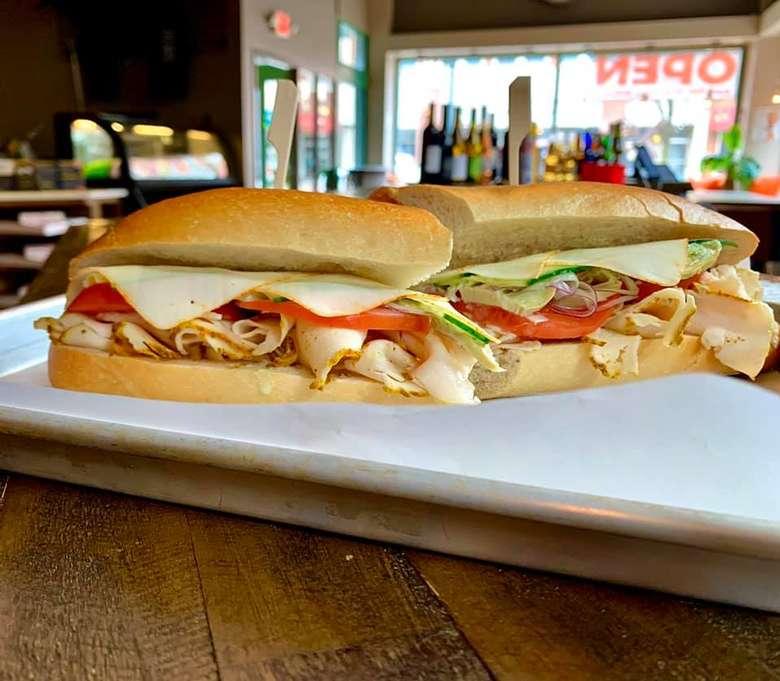 an Italian sub on a white plate