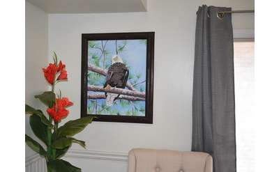 painting of an eagle on a living room wall