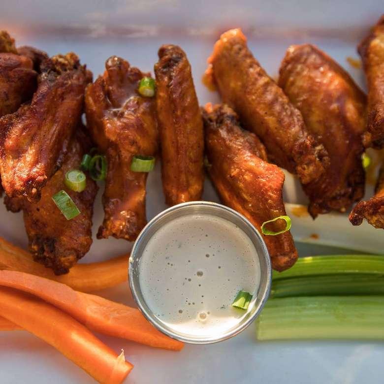 chicken wings, sauce, carrots, celery