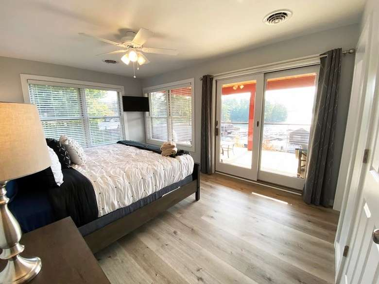 bedroom with a bed and sliding glass doors leading to a balcony