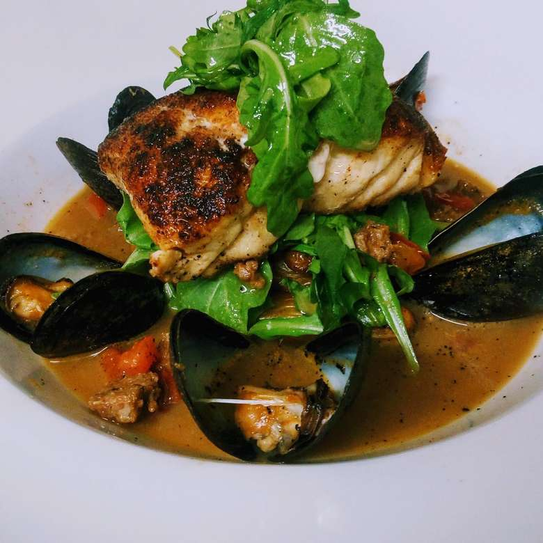 plate of mussels and fish
