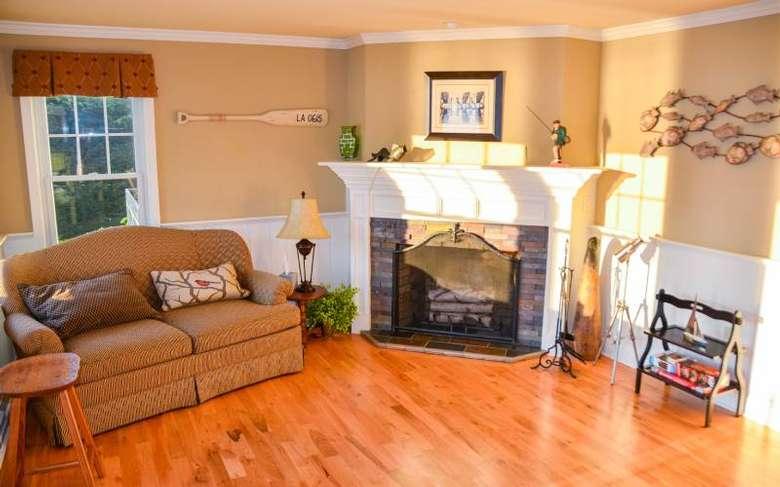 a fireplace next to a brown sofa