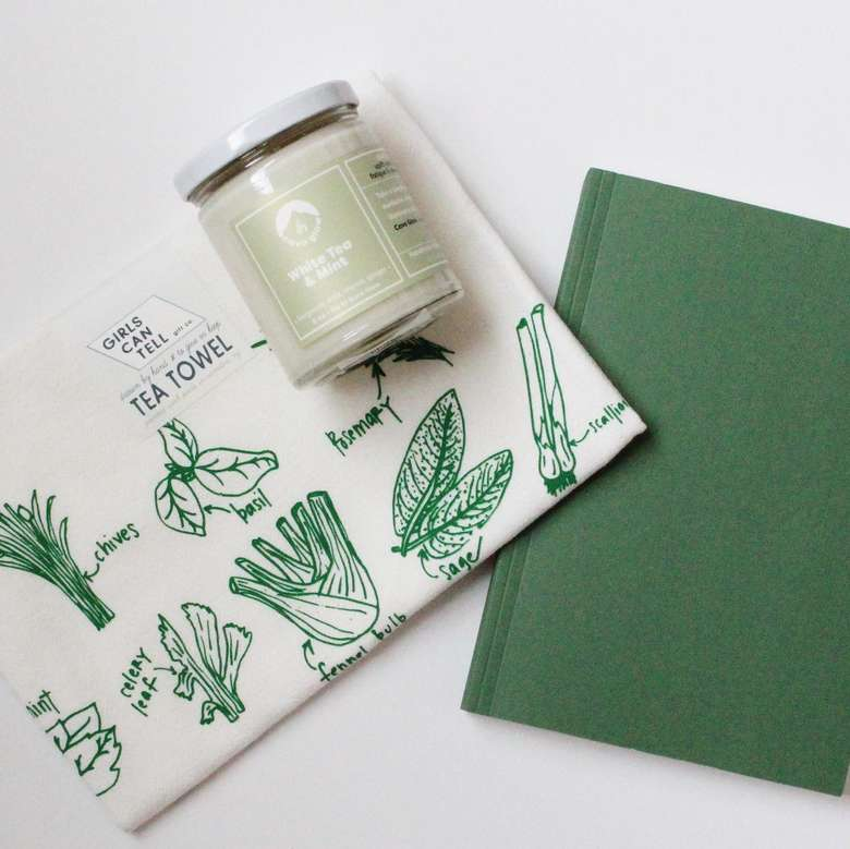 tea towel, candle, and notebook