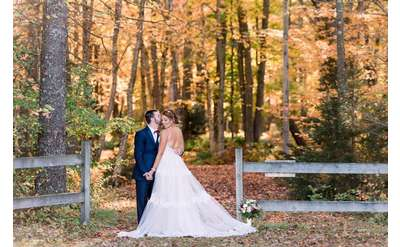 bride and groom in the fall