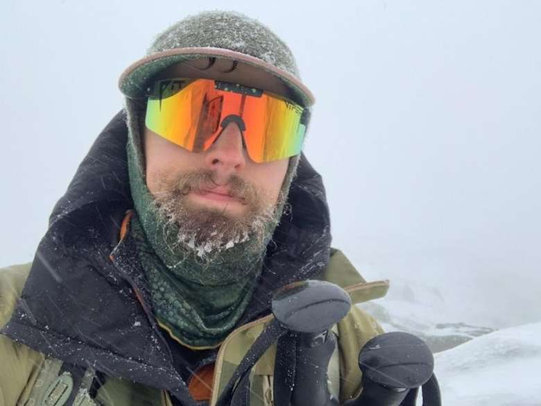 a man with orange reflective winter goggles