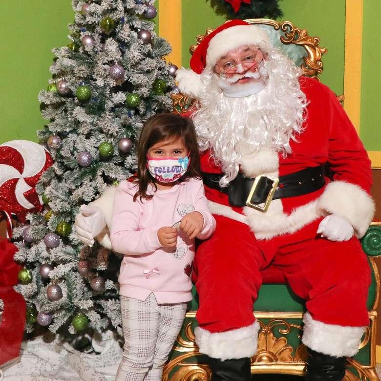 Santa and kid posing