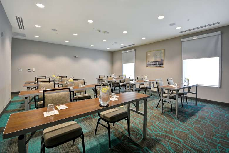 tables and chairs in a meeting room