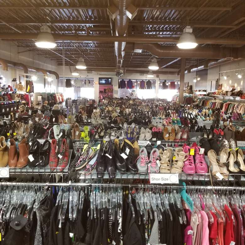 tons of clothes and shoes in store