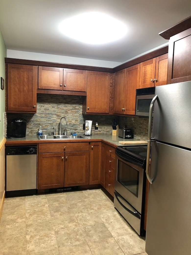 sink, oven, and cabinets in a kitchen