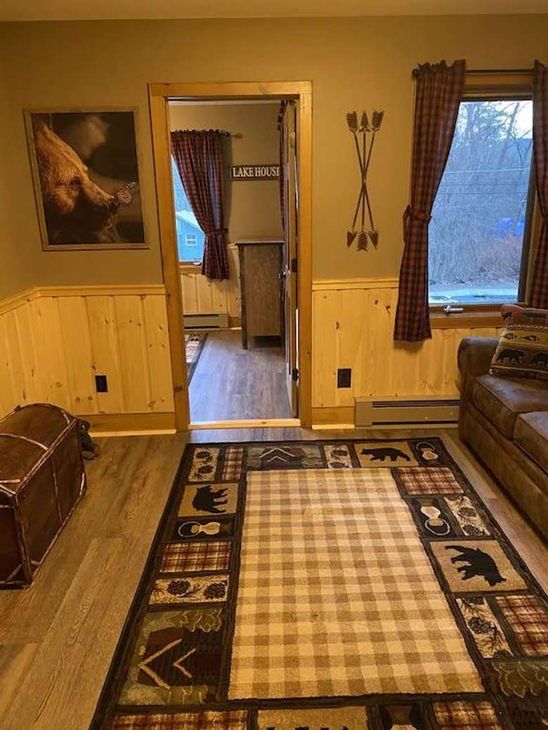 a rustic rug and a bedroom entrance