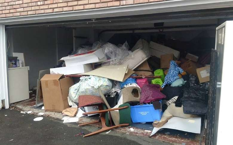 garage filled with boxes and junk