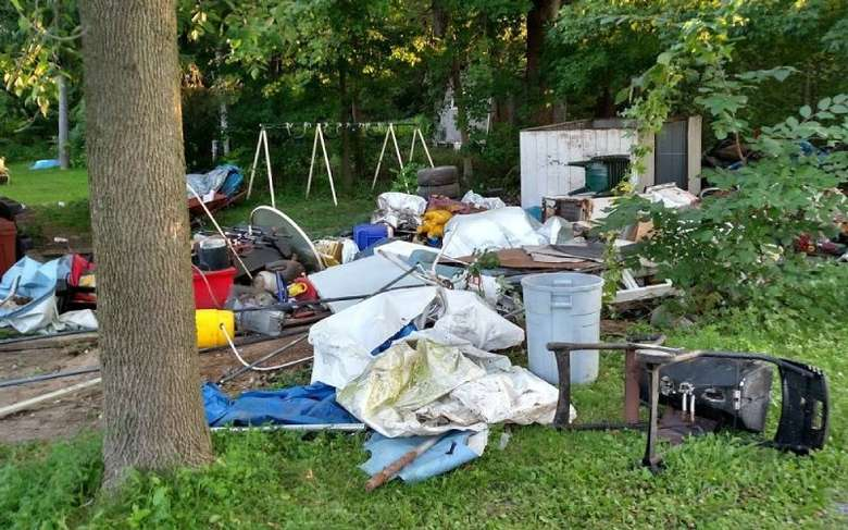 a yard with junk spread around