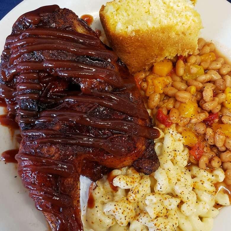 bbq chicken with beans, macaroni salad, and cornbread