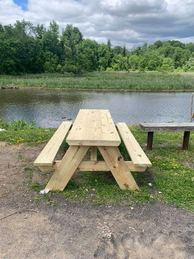 a picnic table by a waterway