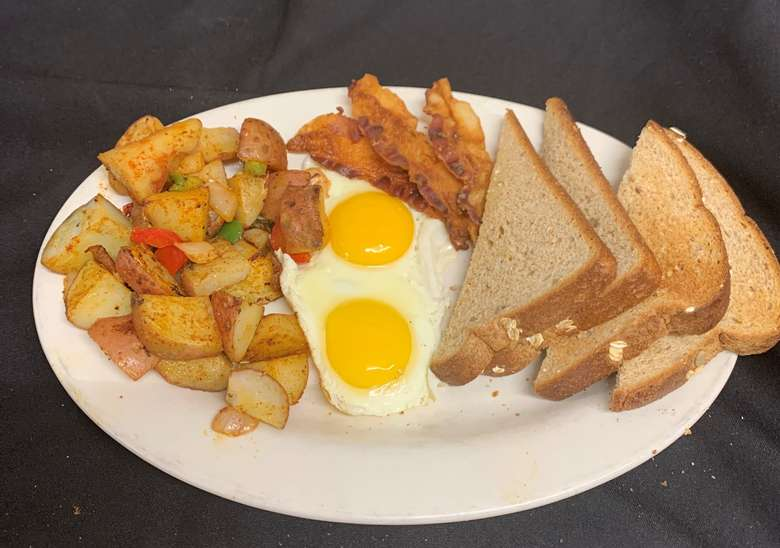 eggs, toast, bacon, and potatoes