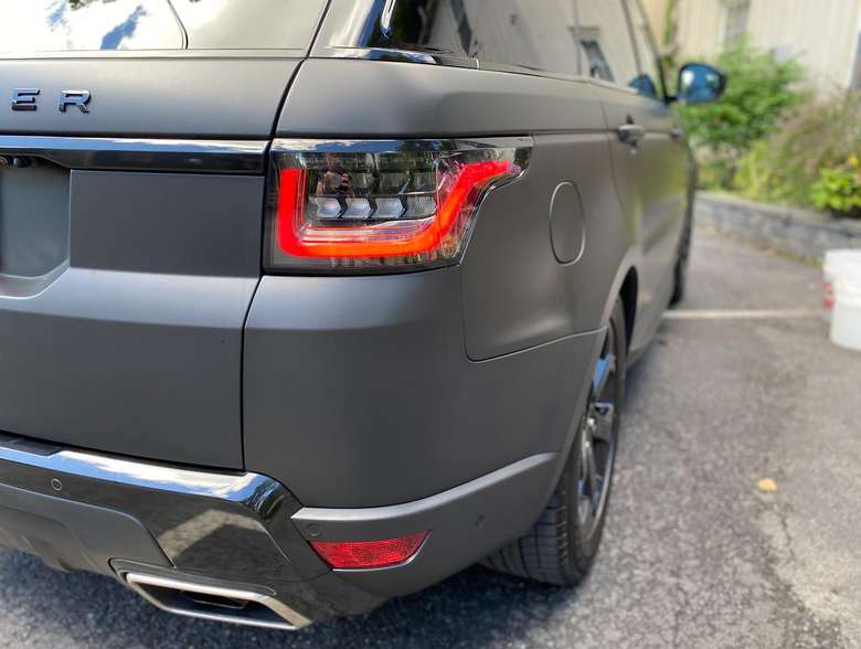 the back end of a dark gray car