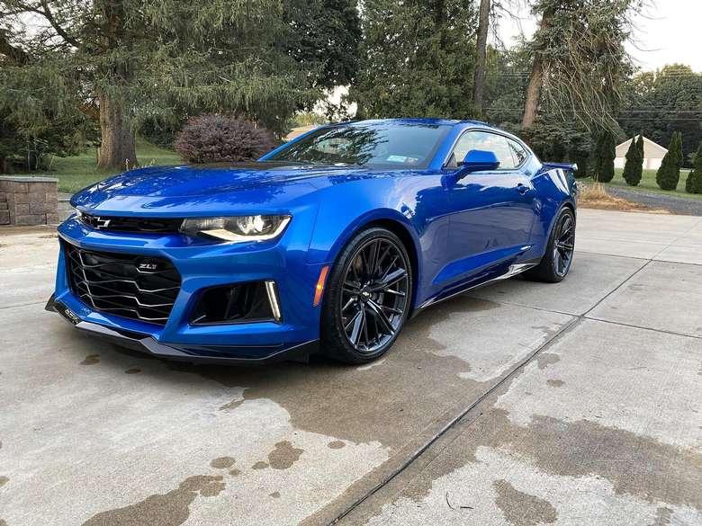a blue car in a driveway