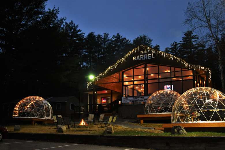outside of a restaurant with dining igloos