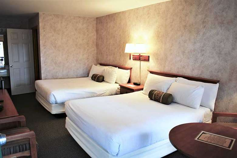 two queen size beds in a hotel room