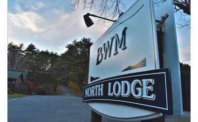 sign that reads BWM north lodge