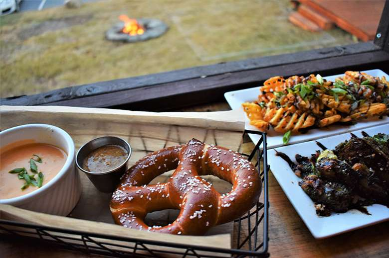 pretzel and dips and other appetizers on a table