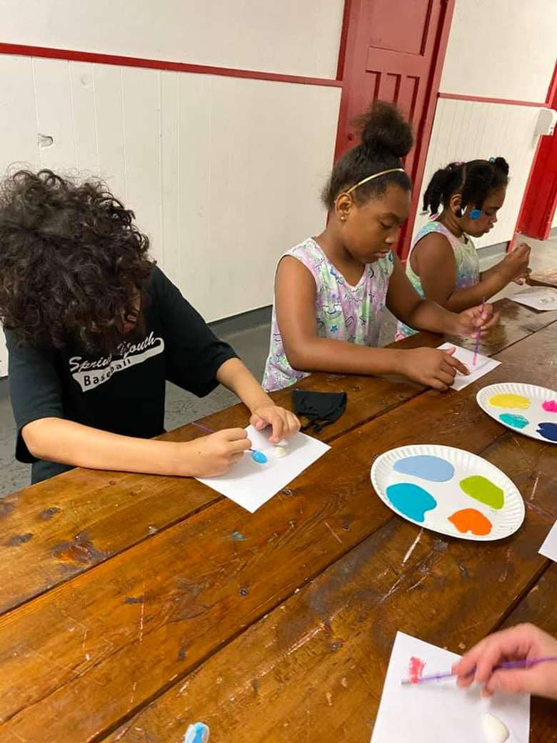 kids painting at a table