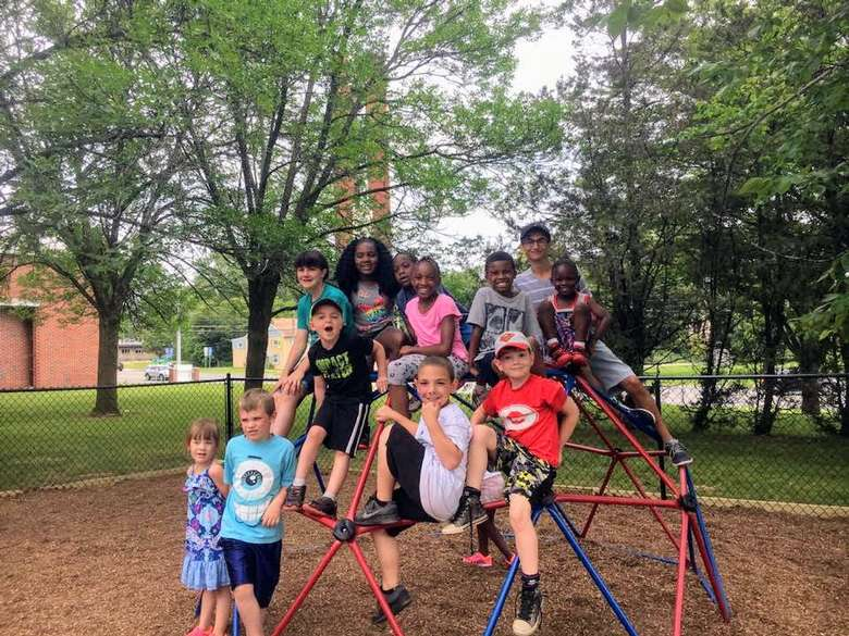 group of kids on playground structure