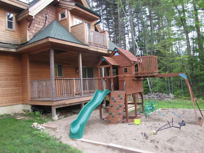 playhouse, swingset, and sandbox