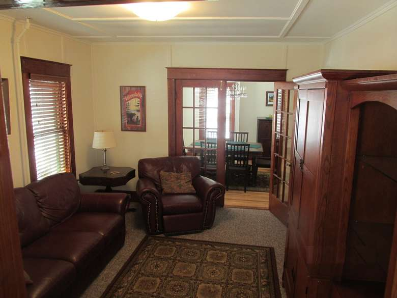 living room with brown furniture